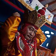 Mongolia. ceremony of divination in a yurt,  Shaman buddhist monk ,  with special clothes , .   Ulan Baatar -  in Remy Laurens camp.  / ceremonie de divination chamanique , moine bouddhiste, habillé en chaman .  dans une yourte , toursites  Oulan Bator - Mongolie camp de remy Laurens
