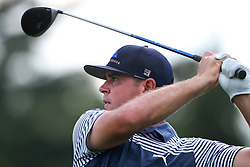 September 20, 2018 - Atlanta, GA, USA - Gary Woodland tees off on the 18th hole with a driver on his way to a birdie to finish at 4-under par during the first round of the Tour Championship on Thursday, Sept. 20, 2018, in Atlanta, Ga. (Credit Image: © Curtis Compton/Atlanta Journal-Constitution/TNS via ZUMA Wire)