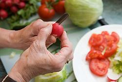 Preparing a salad,