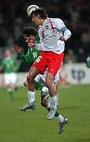 Photo. PIOTR HAWALEJ/Digitalsport<br /> Poland v Northern Ireland<br /> 30/03/2005<br /> 2006 World Cup Qualifier<br /> Poland's Jacek Bak /6/ and Northern Ireland's James Quinn battle for the ball