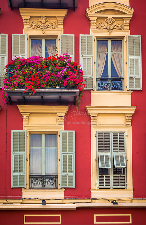 Typical French windows on residential building near the port in Nice, France.<br /> .....<br /> Nice is the fifth most populous city in France, after Paris, Marseille, Lyon and Toulouse, and it is the capital of the Alpes Maritimes département. The urban area of Nice extends beyond the administrative city limits with a population of about 1 million on an area of 278 sq mi. Located on the south east coast of France on the Mediterranean Sea, Nice is the second-largest French city on the Mediterranean coast and the second-largest city in the Provence-Alpes-Côte d'Azur region after Marseille.<br /> <br /> The city is called Nice la Belle, which means Nice the Beautiful, which is also the title of the unofficial anthem of Nice, written by Menica Rondelly in 1912. The area of today's Nice contains Terra Amata, an archaeological site which displays evidence of a very early use of fire. Around 350 BC, Greeks of Marseille founded a permanent settlement and called it Nikaia, after Nike, the goddess of victory. Through the ages, the town has changed hands many times. Its strategic location and port significantly contributed to its maritime strength. For years it was a dominion of Savoy, then became part of France between 1792 and 1815, when it was returned to Piedmont-Sardinia until its reannexation by France in 1860.<br /> <br /> The natural beauty of the Nice area and its mild Mediterranean climate came to the attention of the English upper classes in the second half of the 18th century, when an increasing number of aristocratic families took to spending their winter there. The city's main seaside promenade, the Promenade des Anglais ('the Walkway of the English') owes its name to the earliest visitors to the resort. For decades now, the picturesque Nicean surroundings have attracted not only those in search of relaxation, but also those seeking inspiration. The clear air and soft light has been of particular appeal to some of Western culture's most outstanding painters, such as Marc Chagall, Henri Matisse