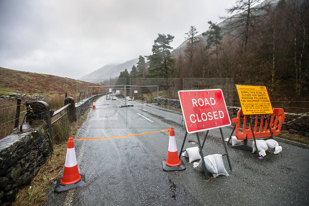 © Licensed to London News Pictures. 26/02/2016. Grasmere UK. File picture shows the A591 road collapse in Cumbria which is costing the Lake district £1m a day according to Liberal Democrat Leader Tim Farron. The MP for Westmorland & Lonsdale has called for extra staff to speed up repairs to the A591 which was damaged by storm Desmond in December. Mr Farron told the commons the South Lakes economy would lose about £100m if the road remained closed until the end on may with £60m of this lost in April & May. Photo credit: Andrew McCaren/LNP