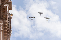© Licensed to London News Pictures. 10/05/2015. London, UK. A fly-by with a Spitfire flanked by two Hurricanes after war veterans and servicemen parade through Whitehall as part of the VE Day, 70th anniversary celebrations. Photo credit : Stephen Chung/LNP