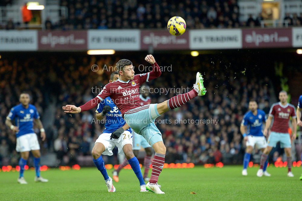 Aaron Cresswell of West Ham United in action. Barclays Premier league match, West Ham Utd v Leicester city at the Boleyn ground, Upton Park in London on Sat 20th December 2014.<br /> pic by John Patrick Fletcher, Andrew Orchard sports photography.