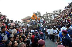 September 15, 2016 - Kathmandu, Nepal - Devotees pulling the chariot of Living Goddess of Nepal 'Kumari' on the third day of Indra Jatra Festival celebrated at Basantapur Durbar Square, Kathmandu. Devotees celebrated the god of rain 'Indra' for 8 days in Kathmandu. (Credit Image: © Narayan Maharjan/Pacific Press via ZUMA Wire)