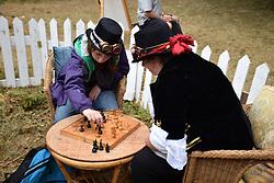 Latitude Festival 2017, Henham Park, Suffolk, UK. Playing chess at Dash Arts Dacha