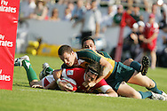 Rhodri McAtee of Wales is brought up just short of the line as the Welsh try hard to get a score. IRB Emirates airline Dubai sevens 2008. match 10 action, Pool A Wales v Australia at the Sevens Stadium in Dubai on Friday 28th November 2008..pic by Andrew Orchard.