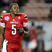 Louisville Cardinals quarterback Teddy Bridgewater (5) is seen prior to  the NCAA Football Russell Athletic Bowl football game between the Louisville Cardinals and the Miami Hurricanes, at the Florida Citrus Bowl on Saturday, December 28, 2013 in Orlando, Florida. Louisville won the game by a score of 36-9. (AP Photo/Alex Menendez)