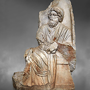 Roman Sebasteion relief  sculpture of a seated god or king, , Aphrodisias Museum, Aphrodisias, Turkey.  <br /> <br />  An older bearded god or mythological King sits on a throne. He held a sceptre and wears a royal diadem and a richly carved tunic and cloak