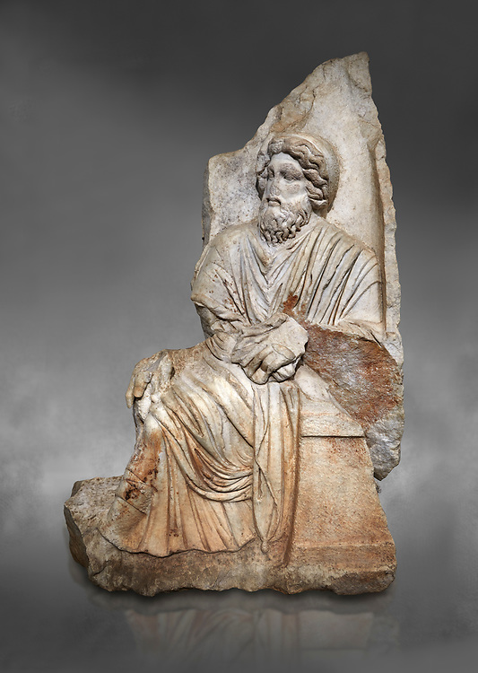 Roman Sebasteion relief  sculpture of a seated god or king, , Aphrodisias Museum, Aphrodisias, Turkey.  <br /> <br />  An older bearded god or mythological King sits on a throne. He held a sceptre and wears a royal diadem and a richly carved tunic and cloak .<br /> <br /> If you prefer to buy from our ALAMY STOCK LIBRARY page at https://www.alamy.com/portfolio/paul-williams-funkystock/greco-roman-sculptures.html . Type -    Aphrodisias     - into LOWER SEARCH WITHIN GALLERY box - Refine search by adding a subject, place, background colour, museum etc.<br /> <br /> Visit our ROMAN WORLD PHOTO COLLECTIONS for more photos to download or buy as wall art prints https://funkystock.photoshelter.com/gallery-collection/The-Romans-Art-Artefacts-Antiquities-Historic-Sites-Pictures-Images/C0000r2uLJJo9_s0
