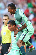 The player Cristiano Ronaldo of Portugal celebrates his goal with teammate Nani during the match against Hungary valid for F European Championship Group 2016 in Stade des Lumières in Lyon, France, on Wednesday.