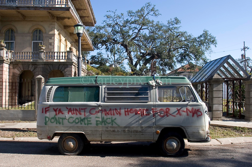 21 December 05. New Orleans, Louisiana. Post Katrina aftermath. <br /> New Orleans Christmas decorations. A VW camper van showing flood levels waits to be towed from Leda Street in Mid City. <br /> Photo; ©Charlie Varley/varleypix.com
