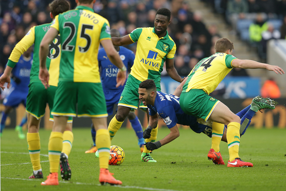Leicester City's Nathan Dyer is upended by Norwich City's Ryan Bennett<br /> <br /> Photographer Stephen White/CameraSport<br /> <br /> Football - Barclays Premiership - Leicester City v Norwich City - Saturday 27th February 2016 - King Power Stadium - Leicester<br /> <br /> © CameraSport - 43 Linden Ave. Countesthorpe. Leicester. England. LE8 5PG - Tel: +44 (0) 116 277 4147 - admin@camerasport.com - www.camerasport.com