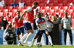 England's Gary Cahill (left) and Raheem Sterling warm up during the International Friendly match at Wembley Stadium, London.