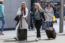 May 4, 2019 - London, UK, UK - London, UK. Two women arrives at Kings Cross rail station with suitcases, travelling for the May Bank holiday weekend. According to the Met Office many parts of the UK will have snow, hail and thunder for the weekend and the temperature for the May Bank holiday could drop to as low as -6 degrees celsius. (Credit Image: © Dinendra Haria/London News Pictures via ZUMA Wire)