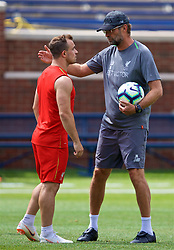 ANN ARBOR, USA - Friday, July 27, 2018: Liverpool's manager Jürgen Klopp speaks with new signing Xherdan Shaqiri during a training session ahead of the preseason International Champions Cup match between Manchester United FC and Liverpool FC at the Michigan Stadium. (Pic by David Rawcliffe/Propaganda)