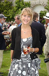 "LADY CANDIDA BALFOUR at a luncheon hosted by Cartier at the 2004 Goodwood Festival of Speed on 27th June 2004.  Cartier sponsored the ""Style Et Luxe' for vintage cars on the final day of this annual event at Goodwood House, West Sussex."
