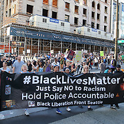 Protesters take part in a Black Lives Matter march, Saturday, August 26, 2017, in Seattle, Washington. Several thousand people attended a downtown rally and then marched through the city to call attention to minority rights and police brutality. (Alex Menendez via AP)