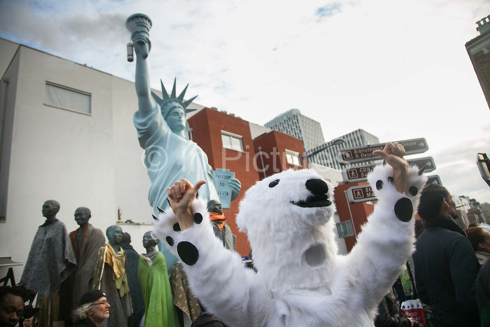 Danish MP Christian Poll temping for atist Jens Galshiøt as a polar bear. Citizen Climate Summit in Montreuil. A host of organisations, small NGOs, political art events and food stalls set the scene for discussions and debates on climate change as an alternative to the offical COP21 in Bourget.  The official climate talks in Paris is on and the pressure to come up with a sustainable legally binding is high. In the aftermath of recent terrorist attacks public demonstrations have been banned during the 2 weeks of climate talks