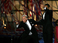 Barak Obama and Senator Joseph Biden and family wave  at the last night of the Democratic Convention in Denver, Colorado.  Photograph by Dennis Brack
