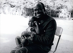 Dec. 16, 1975 - southern Sudan : General Mustafa Adrisi, former Vice President and Defence Minister in Idi Amin's regime pictures here with one of his 36 children now living in Southern Sudan. (Credit Image: © Keystone Pictures USA/ZUMAPRESS.com)