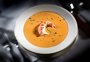 """SHOT 1/8/08 5:03:37 PM - Morton's Steakhouse Lobster Bisque ($13) and Morton's Downtown executive chef Bob Wiltshire. Morton's, The Steakhouse (formerly Morton's of Chicago) was founded in 1978 by Arnie Morton and Klaus Fritsch. Today, there are over 78 locations in the chain. Morton's locations are decorated with a similar style, concept, and decor, and all locations but one have """"Boardrooms,"""" private dining and meeting facilities. Approximately 80% of the business for Morton's is based on business expense accounts, with an average guest bill being $87. 80% of the entrees ordered are beef, while that total makes up 38% of the restaurant's overall sales. Morton's, The Steakhouse serves prime beef, the highest grade given by the USDA, sourced from a meat packer in Chicago, IL. The meat is aged on location for 2-3 weeks using a wet-aging process which means the meat is aged inside of a cryo-vacuumed bag. The meat is cooked to order on a 1,200 degree broiler for service. Meat offered on the menu includes a double cut filet mignon, porterhouse steak, double porterhouse,New York strip steak, Chicago style bone-in ribeye steak, prime rib, single cut filet mignon, along with a few styled preparations which include Filet Oskar, Filet Diane, and a cajun ribeye steak..(Photo by Marc Piscotty / © 2008)"""