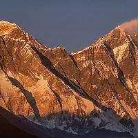 The sun sets on Mounts Everest and Lhotse in the Khumbu Region of Nepal.