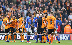 Wolverhampton Wanderers' Helder Costa (2nd left) is fouled by Birmingham's Harlee Dean (pleading) who is sent off for the tackle by referee Andy Davis during the match at the Molineux ground
