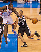 June 2, 2012; Oklahoma City, OK, USA; Oklahoma City Thunder center Kendrick Perkins (5) applies pressure as San Antonio Spurs guard Tony Parker (9) dribbles the ball during a playoff game  at Chesapeake Energy Arena.  Thunder defeated the Spurs 109-103 Mandatory Credit: Beth Hall-US PRESSWIRE