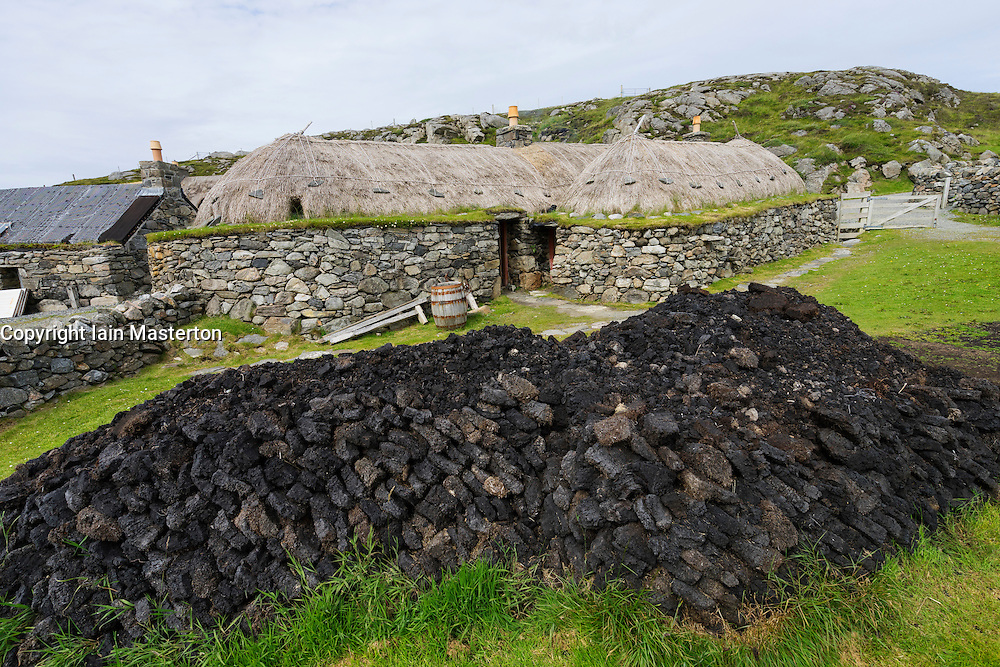 Traditional blackhouse  cottage and peat supply at Gearrannan blackhouse village on Isle of Lewis in Outer Hebrides Scotland United Kingdom