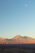 Desert on sunny day and moon on sky, Atacama Desert, Chile