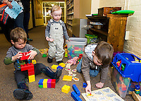 """Adam, Reid and Connor have some """"play time"""" with puzzles and blocks following Laconia Library's preschool story hour on Wednesday morning.  (Karen Bobotas/for the Laconia Daily Sun)"""