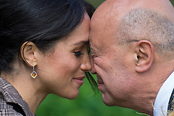 The Duchess of Sussex receives a hongi, a traditional Maori greeting, at an official welcome ceremony at Government House in Wellington, on the first day of the royal couple's tour of New Zealand.