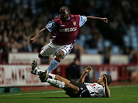 Photo: Lee Earle.<br /> Aston Villa v Fulham. The Barclays Premiership. 21/10/2006. Villa's Didier Agathe (L) jumps over the legs of Michael Brown.