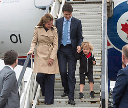Prime Minister Justin Trudeau and his wife, Sophie Gregoire Trudeau, look on as his son Hadrien hops down the stairs as they arrive Dublin, Ireland, Monday, July 3, 2017. Photo by Ryan Remiorz/CP/ABACAPRESS.COM