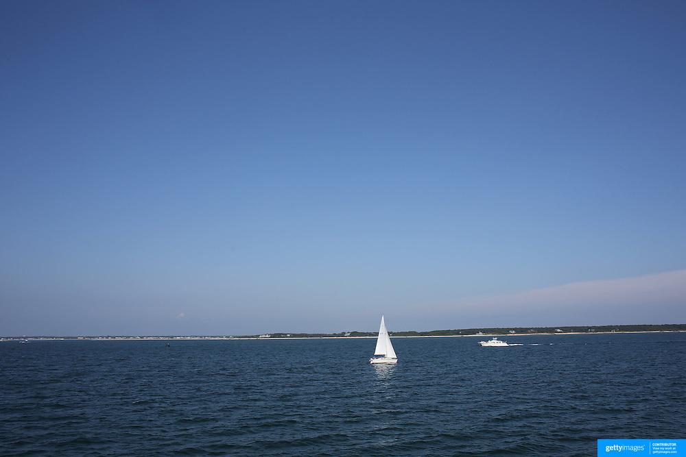 A yacht sailing off the coastline of Nantucket Island, Massachusetts, USA. Photo Tim Clayton