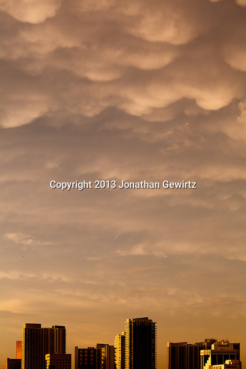 Mammatus clouds float over downtown Miami buildings at arouind sunset, after a storm. WATERMARKS WILL NOT APPEAR ON PRINTS OR LICENSED IMAGES.