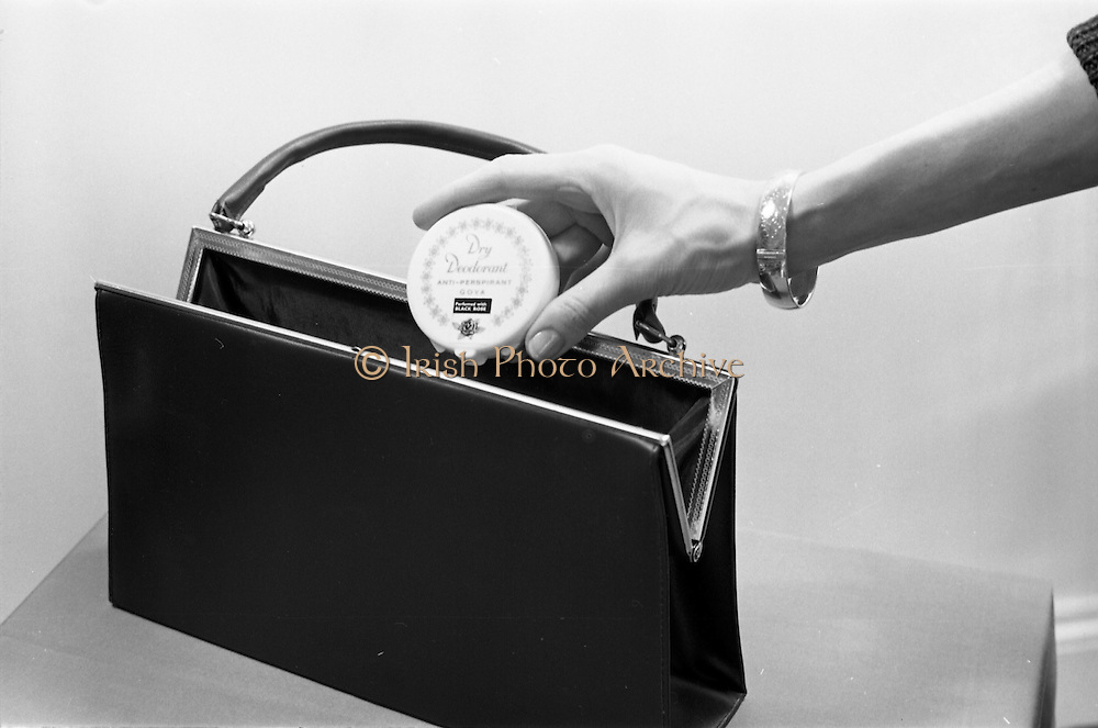 24/03/1966<br /> 03/24/1966<br /> 24 March 1966<br /> Goya Dry Deodorant advertising images shot at Lensmen Studio for R. Wilson Young. Image shows model's hand with deodorant box and handbag.