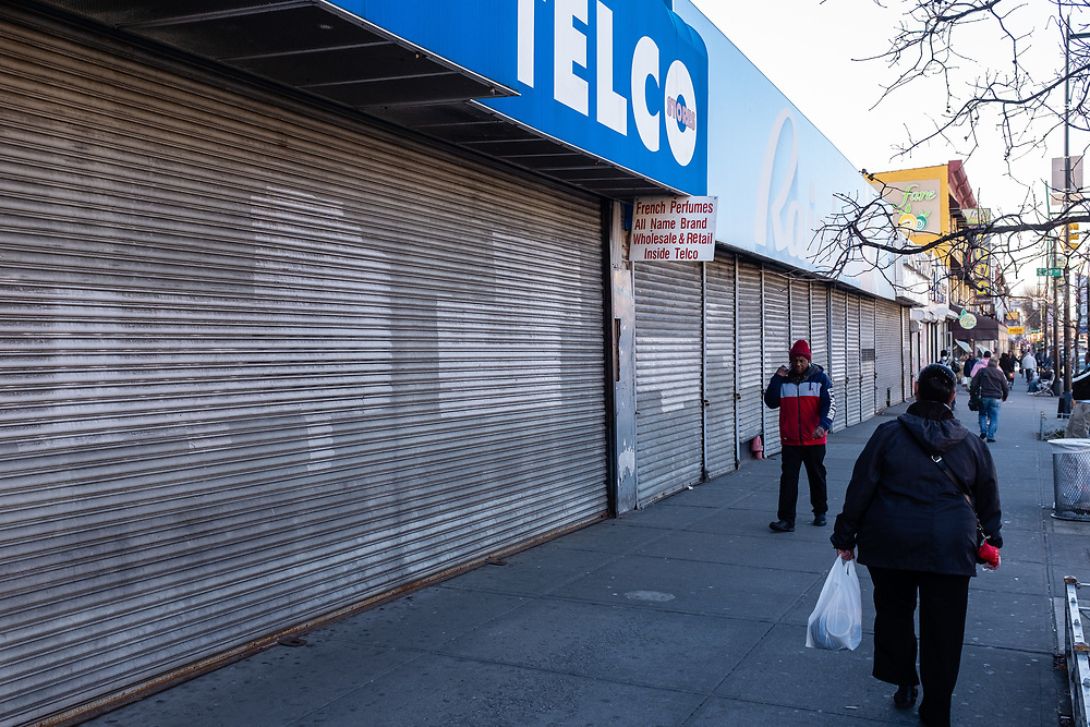 Brooklyn, NY - 27 March 2020. Restrictions on the public during the COVID-19 pandemic have led to store closures throughout Brooklyn's neighborhoods. The discount store Telco and its neighbor Rainbow on Flatbush Avenue are now shuttered.
