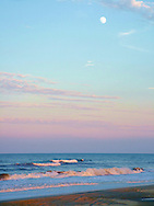 This shot was taken north of Corolla, North Carolina, three miles past where the road ends. The moon was rising, and the sky was a fanatstic mixture of colors.