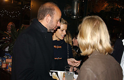 LAURA BAILEY and ERIC FELLNER at a party to celebrate the publication on 'A Year in My Kitchen' by Skye Gyngell held at The Petersham Nurseries, Petesham, Surrey on 19th October 2006.<br /><br />NON EXCLUSIVE - WORLD RIGHTS