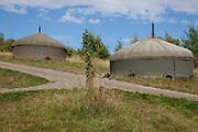 Grey yurts on an organic community farming project, Devon, UK