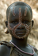 Young Girl with face painted, Mursi Tribe, Mago National Park, Lower Omo Valley, Ethiopia, portrait, person, one, tribes, tribal, indigenous, peoples, Southern, ethnic, rural, local, traditional, culture, primitive,