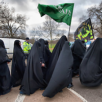 LONDON, ENGLAND - DECEMBER 27:  A group of  Shia Muslim women with flags and banners take part in the Ashura procession from Marble Arch to Holland Park Mosque on December 27, 2009 in London, England. Ashura is a 10 day period of mourning for Imam Hussein, the seven-century grandson of Prophet Mohammad who was killed in a battle in Karbala in Iraq, in 680 AD.  (Photo by Marco Secchi/Getty Images)