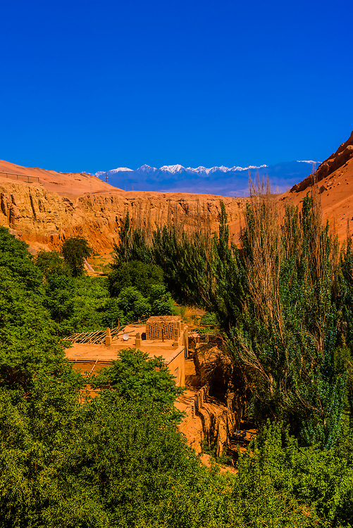 Bezelik Thousand Buddha Caves, Flaming Mountains (foothills of Tian Shan mountain range), near Turpan, Xinjiang. The caves were built between 5th and 9th century. Buddhist sculpture and wall frescoes were destroyed after Islam came to the region in the 13th century.