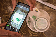 Clean crockery, china cups and plates, are on the table in a sealed plastic wrapping. Using your mobile telephone you scan the QR code, then you see when it was cleaned, where and by whom. All this on the table of a cheap restaurant.