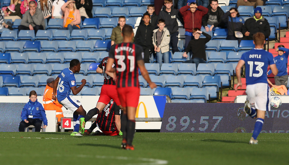 Oldham Athletic's Queensy Menig (left) shoots past Blackburn Rovers' Charlie Mulgrew to score the only goal of the match in the last minute<br /> <br /> Photographer Stephen White/CameraSport<br /> <br /> The EFL Sky Bet League One - Oldham Athletic v Blackburn Rovers - Saturday 14th October 2017 - Boundary Park - Oldham<br /> <br /> World Copyright © 2017 CameraSport. All rights reserved. 43 Linden Ave. Countesthorpe. Leicester. England. LE8 5PG - Tel: +44 (0) 116 277 4147 - admin@camerasport.com - www.camerasport.com