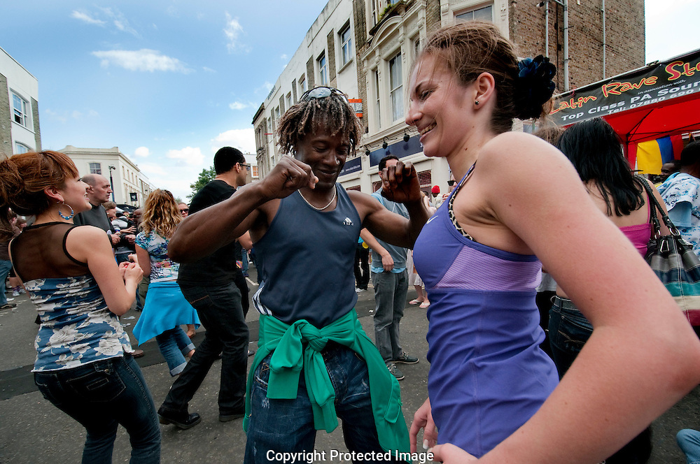 Young people dancing at Notting Hill annual West Indian Carnival in the streets of West London.