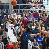 Miyamura's Bishop Begay (11) takes a jump shot as Window Rock's Derian Long (1) defends, Saturday, Nov. 30 at Miyamura High School in Gallup. Window Rock took the win 45-43.