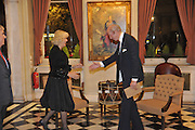 CAMILLA DUCHESS OF CORNWALL IS GREETED BY NICHOLAS PETO, The Lady Joseph Trust, fundraising party.<br /> Camilla, Duchess of Cornwall  attends gala fundraising event as newly appointed President of the charity. The Lady Joseph Trust was formed in 2009 to raise funds to acquire horses for the UK's top Paralympic riders Cavalry and Guards Club, 127 Piccadilly, London,<br /> 26 October 2011. <br /> <br />  , -DO NOT ARCHIVE-© Copyright Photograph by Dafydd Jones. 248 Clapham Rd. London SW9 0PZ. Tel 0207 820 0771. www.dafjones.com.
